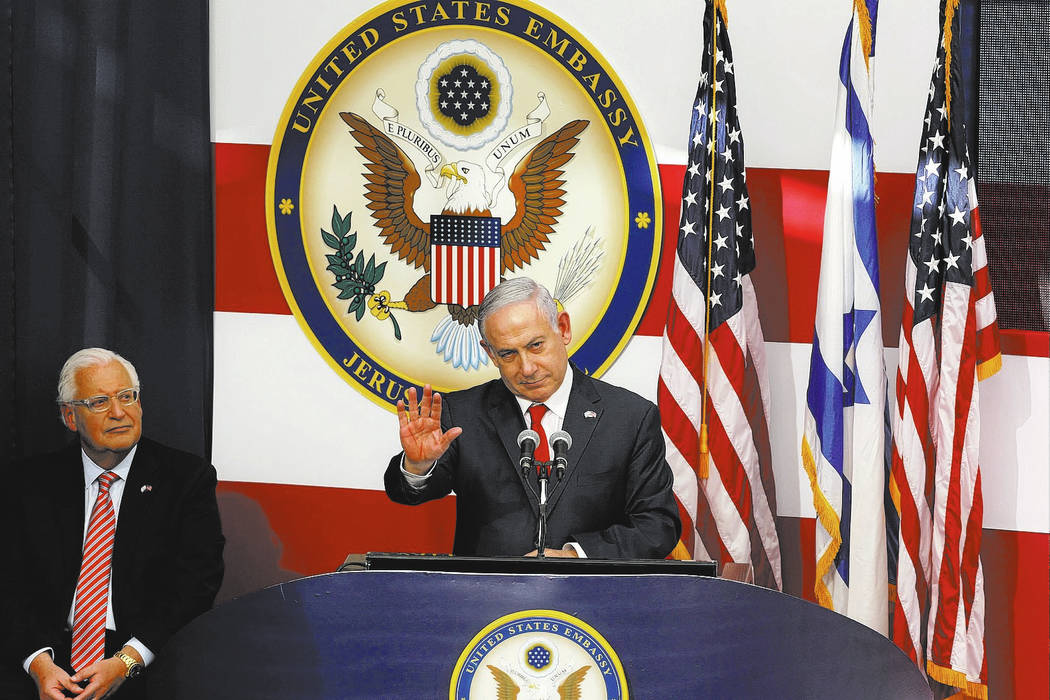 Israeli Prime Minister Benjamin Netanyahu speaks as U.S. Ambassador to Israel David Friedman listens during the opening ceremony of the new US embassy in in Jerusalem, Monday, May 14, 2018. Amid d ...