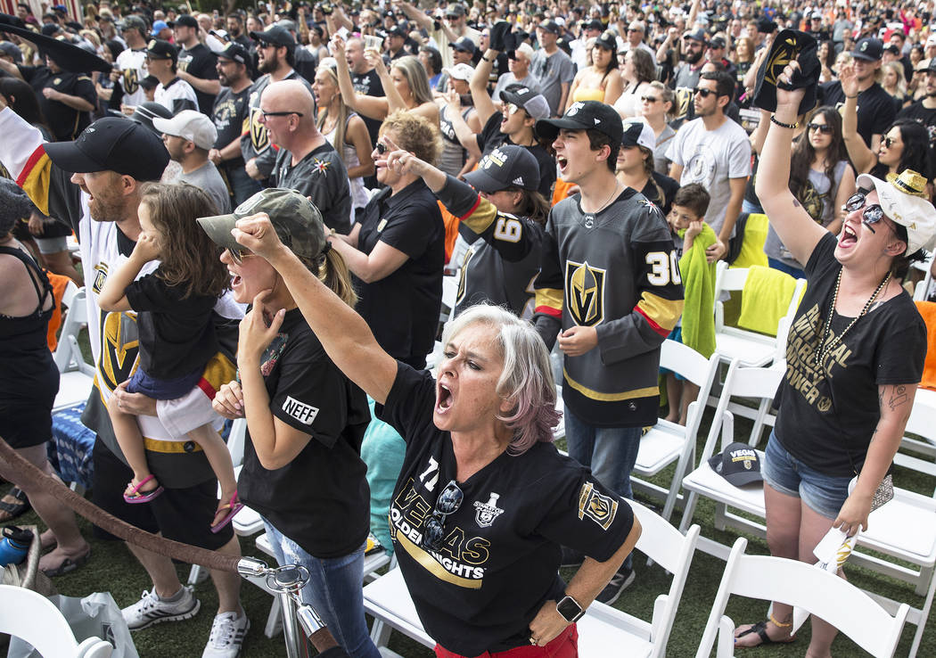 Golden Knights fan Karlotta Sanchez, middle, cheers at a watch party at Red Rock Casino after Golden Knights right wing Alex Tuch scored a first period goal during Vegas' game two NHL Western Conf ...