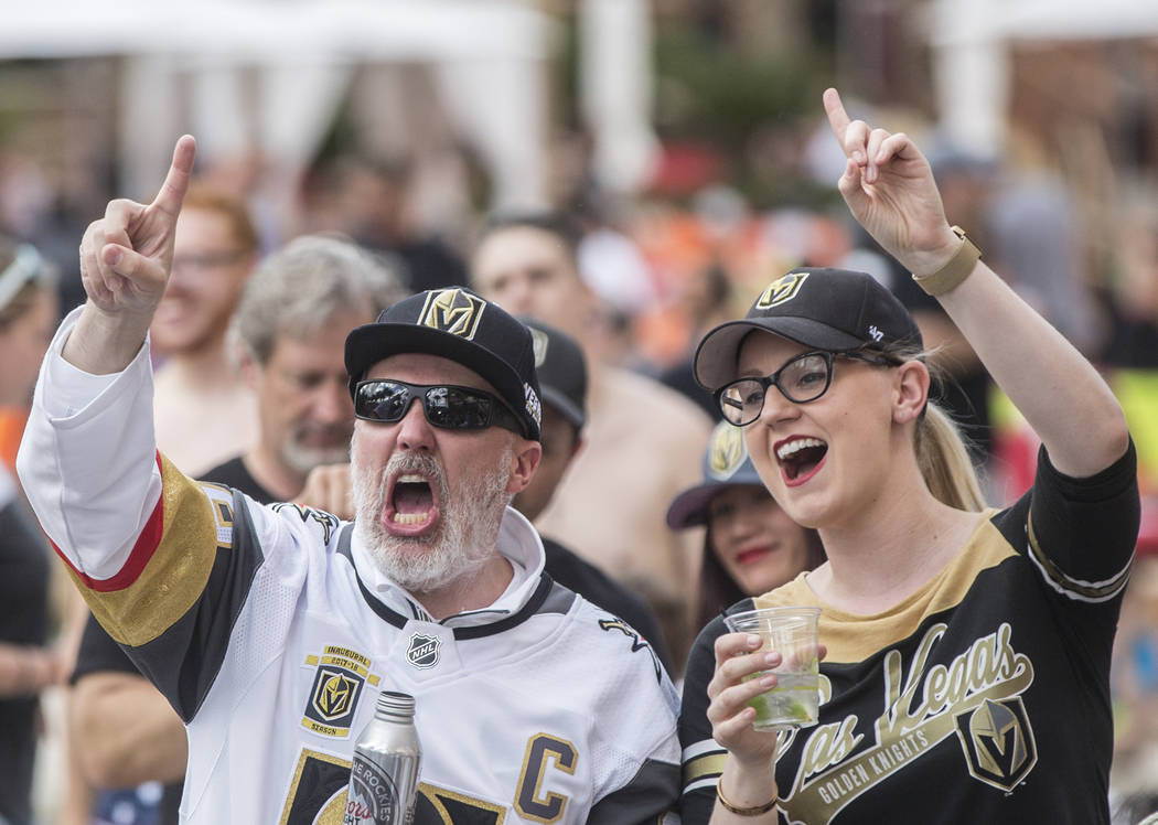 Golden Knights fans Brian Matherly, left, and Jennifer Hendowski cheer at a watch party at Red Rock Casino during Vegas' game two NHL Western Conference Finals road matchup with the Winnipeg Jets ...