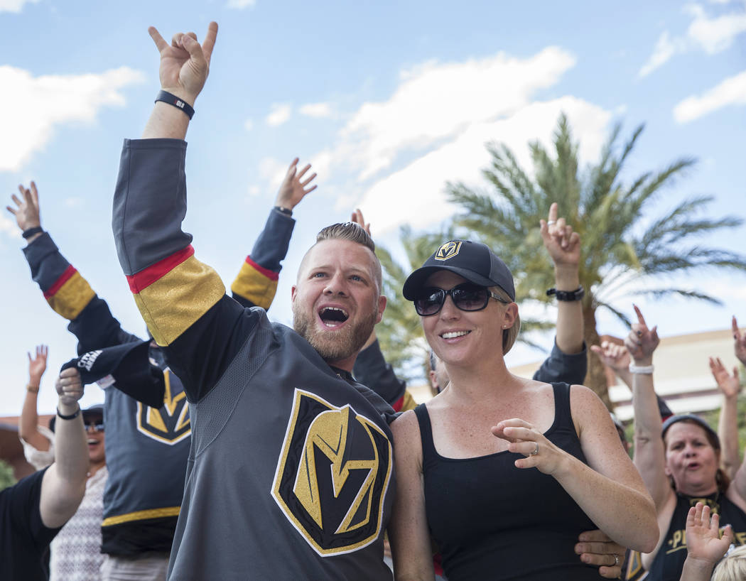Golden Knights fans Eric and Jen Eierdam cheer at a watch party at Red Rock Casino during Vegas' game two NHL Western Conference Finals road matchup with the Winnipeg Jets on Monday, May 14, 2018, ...