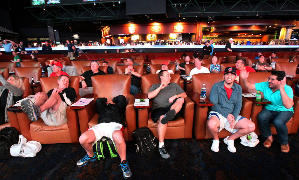 2713aaf8d08 Guests react while watching a basketball game during the NCAA Tournament at  the Westgate Superbook in