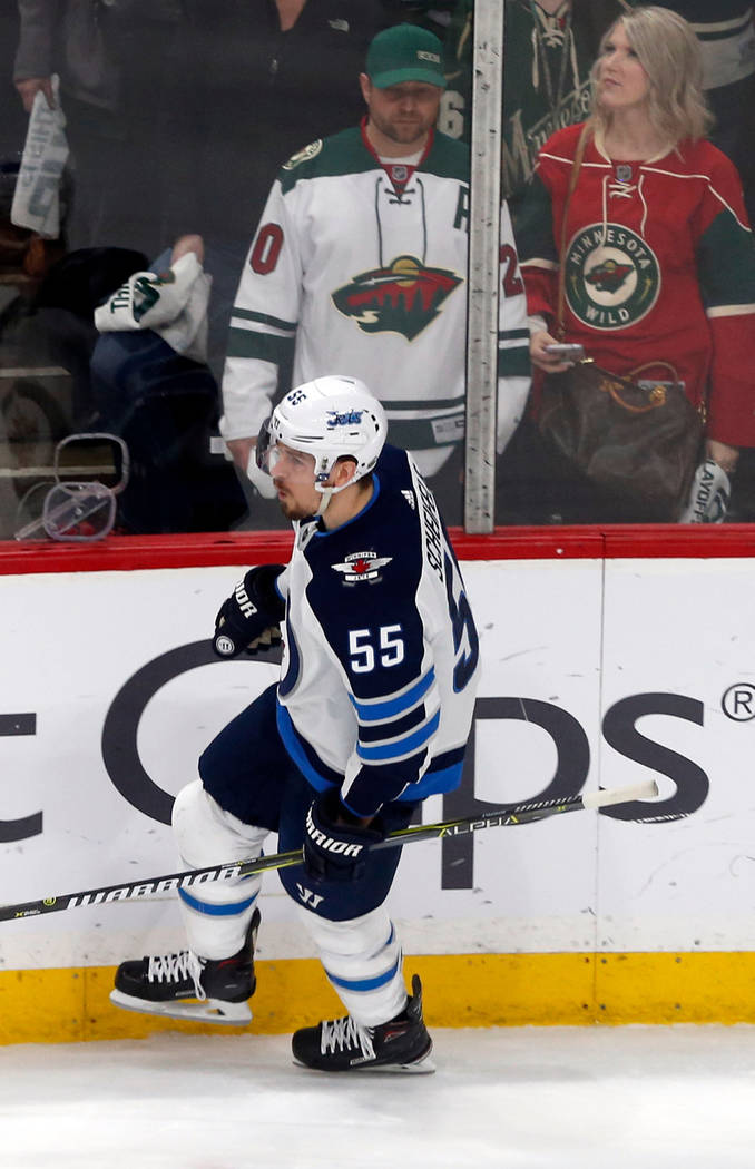 Winnipeg Jets' Mark Scheifele skates by Minnesota Wild fans after scoring an empty-net goal in the third period of Game 4 of an NHL hockey first-round playoff series Tuesday, April 17, 2018, in St ...