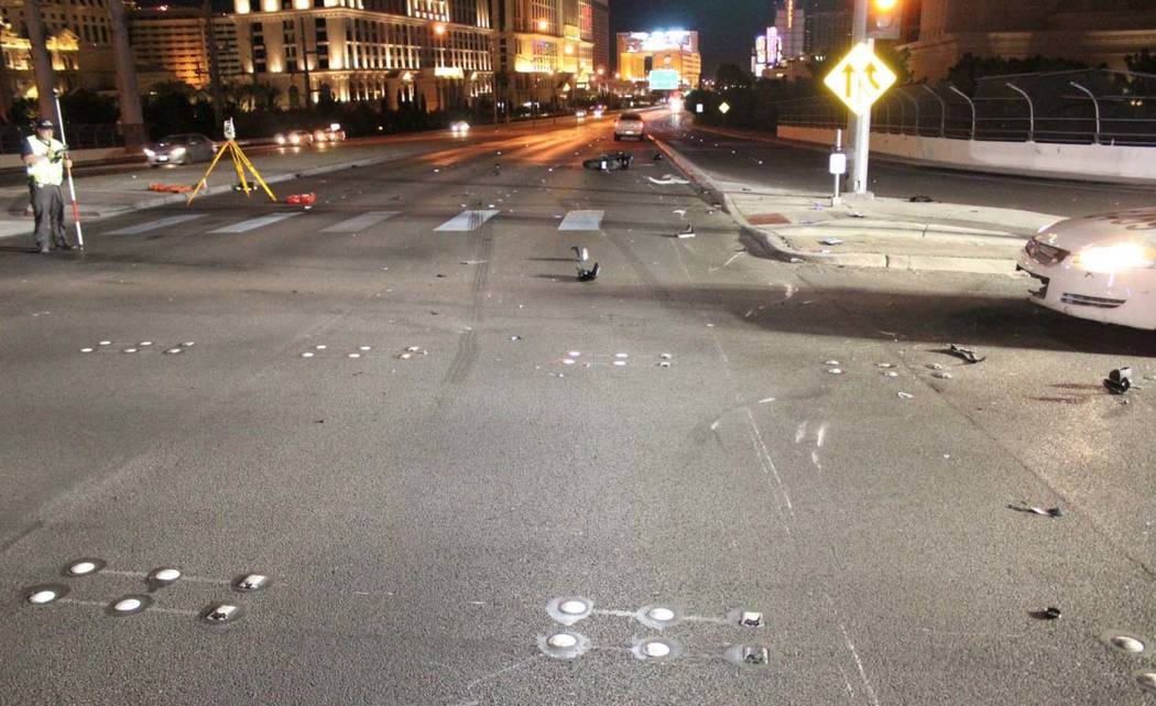 Police work the scene early Sunday morning after a 52-year-old motorcyclist died in a collision with a Cadillac pick-up truck at the northbound off-ramp from I-15 to Flamingo Road in Las Vegas. (L ...