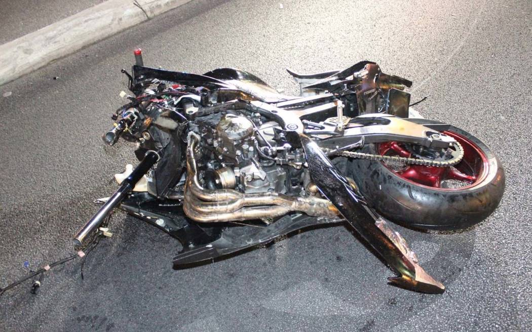 What's left of a motorcyle involved in a collision with a Cadillac pick-up truck lies in the street at the northbound off-ramp from I-15 to Flamingo Road in Las Vegas early Sunday morning. ...