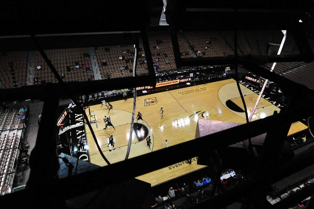 The floor of the Mandalay Bay Events Center is seen behind the arena's lights during a Vegas 16 college basketball game between Oakland and ETSU in the second half of their NCAA college basketball ...