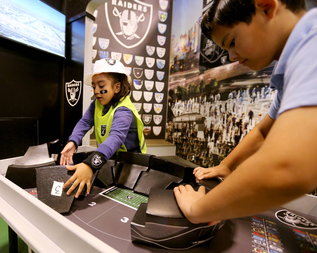 Wendy Carranco, 5, left, and Ricardo Brown, 9, build the stadium at the opening of the Raiders Kids Construction Zone Groundbreaking exhibit at Discovery Children's Museum in Las Vegas Wednesday, ...