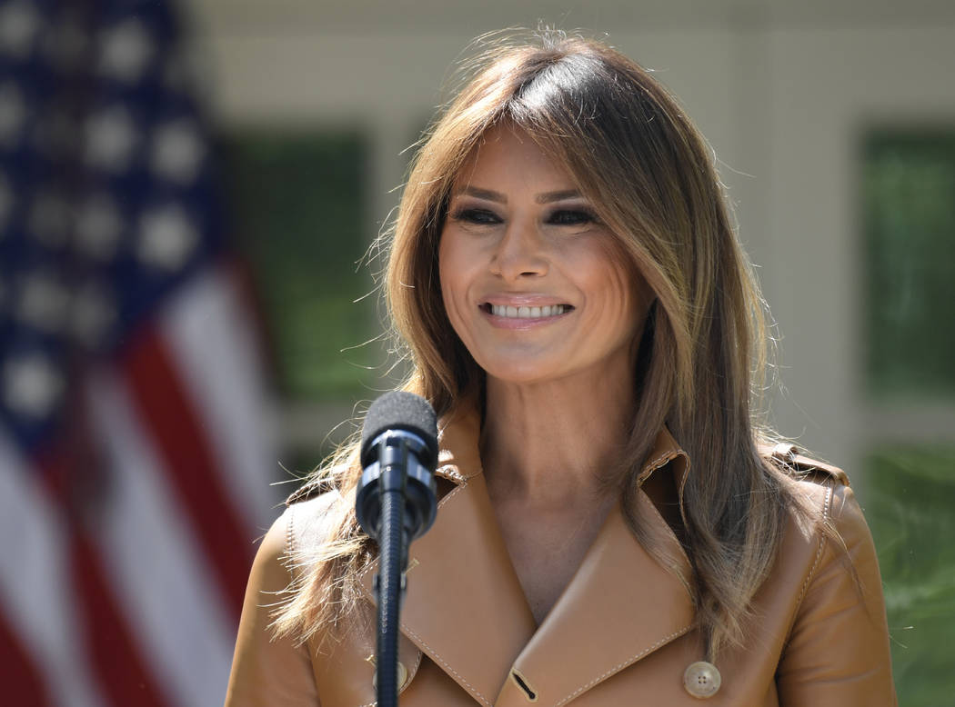 In this May 7, 2018 photo, First lady Melania Trump speaks on her initiatives during an event in the Rose Garden of the White House in Washington. The White House says Melania Trump is hospitaliz ...