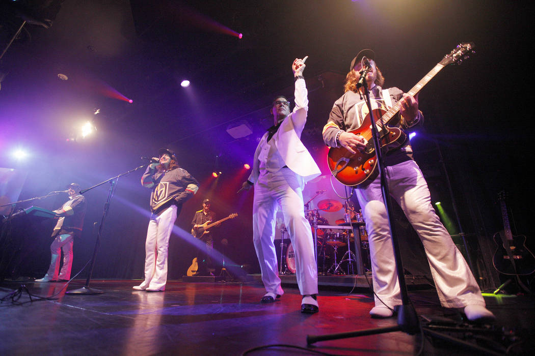 Wayne Hosking as Maurice Gibb, from left, David Scott as Robin Gibb, and Michael Clift as Barry Gibb of the Australian Bee Gees, a Bee Gee tribute band, perform as Review-Journal columnist John Ka ...