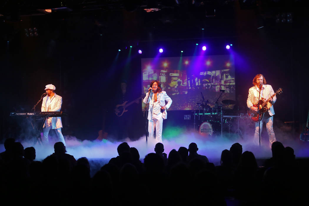 Wayne Hosking as Maurice Gibb, from left, David Scott as Robin Gibb, and Michael Clift as Barry Gibb of the Australian Bee Gees, a Bee Gee tribute band, perform at the Thunder Showroom at the Exca ...