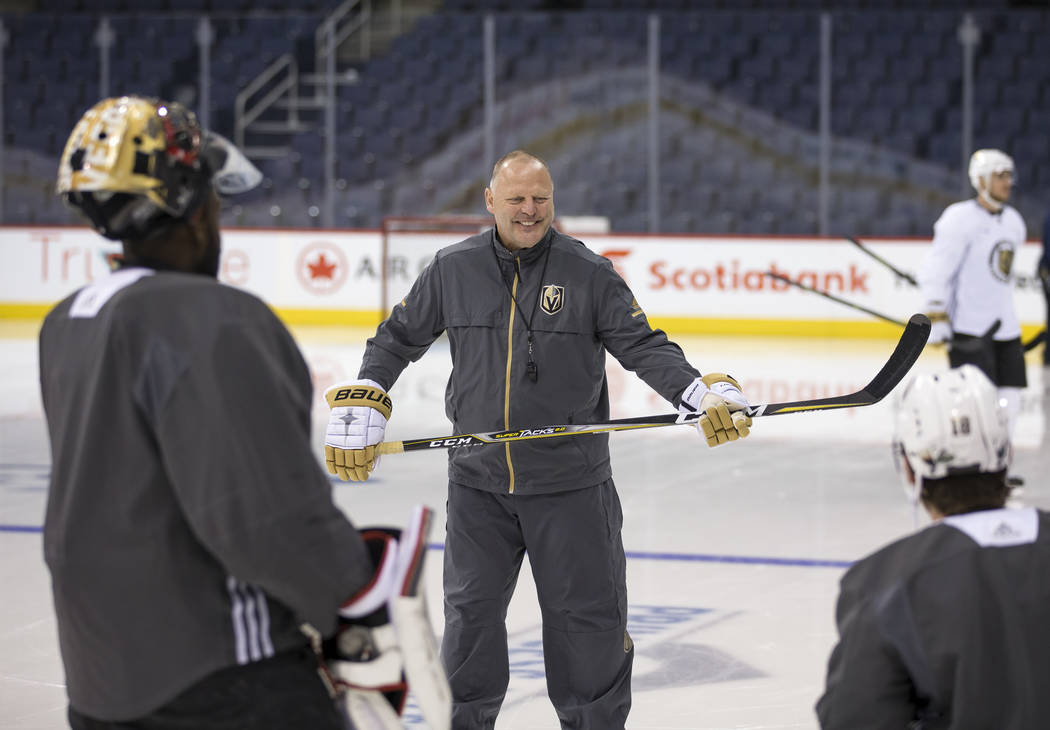 Vegas Golden Knights head coach Gerard Gallant talks to players during their morning skate ahead of Game 2 against the Winnipeg Jets at the Bell MTS Place in Winnipeg, Canada, on Monday, May 14, 2 ...