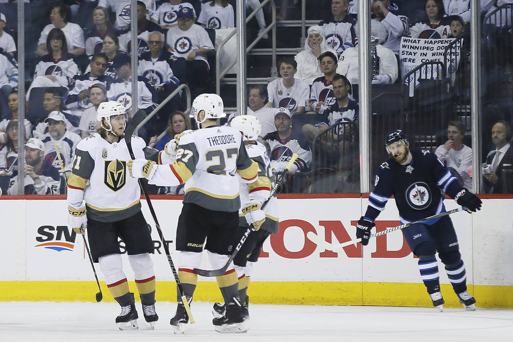 Vegas Golden Knights celebrate a goal by William Karlsson goal against the Winnipeg Jets during the second period of Game 1 of the NHL hockey playoffs Western Conference final, Saturday, May 12, 2 ...