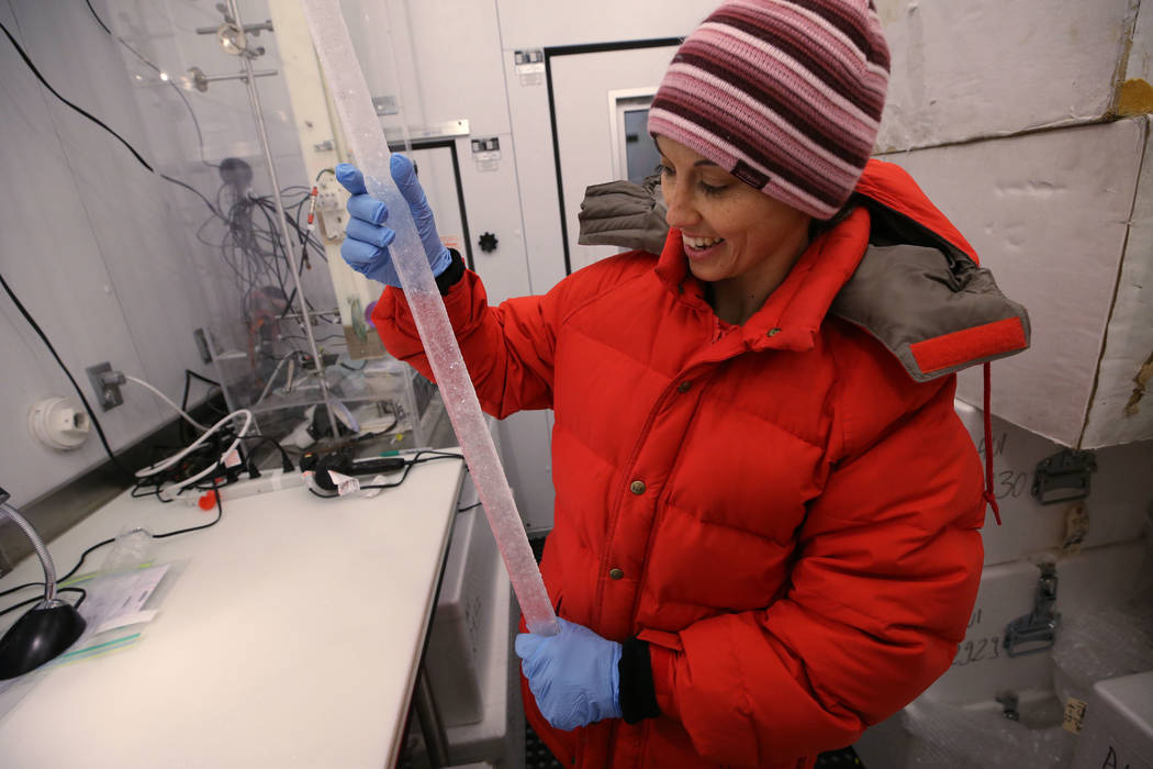 Dr. Monica Arienzo works on a 30,000 year old ice core in the Desert Research Institute ice lab in Reno on Feb. 21, 2018. Cathleen Allison Nevada Momentum