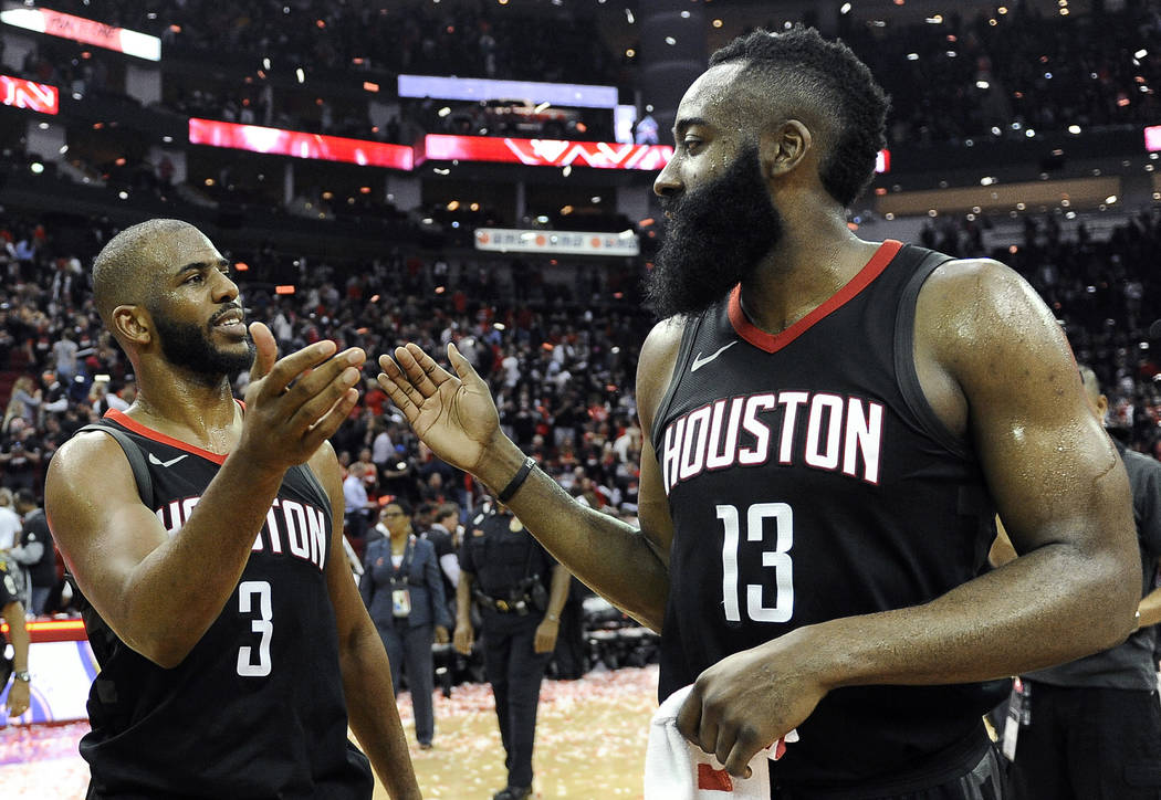 Houston Rockets guard Chris Paul (3) and James Harden celebrate the team's win over the Utah Jazz during Game 5 of an NBA basketball second-round playoff series, Tuesday, May 8, 2018, in Houston. ...