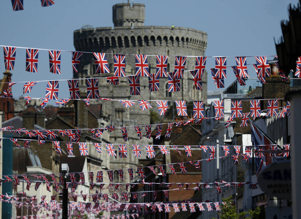 Union Jack flags fly across the main shopping street in Windsor, Tuesday, May 15, 2018. Preparations are being made in the town ahead of the wedding of Britain's Prince Harry and Meghan Markle tha ...
