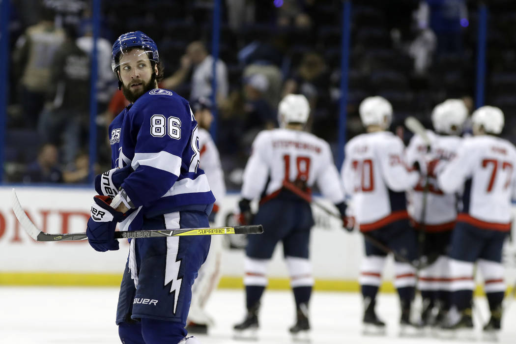 Tampa Bay Lightning right wing Nikita Kucherov (86) leaves the ice as the Washington Capitals celebrate their 6-2 win during Game 2 of the NHL Eastern Conference finals hockey playoff series Sunda ...