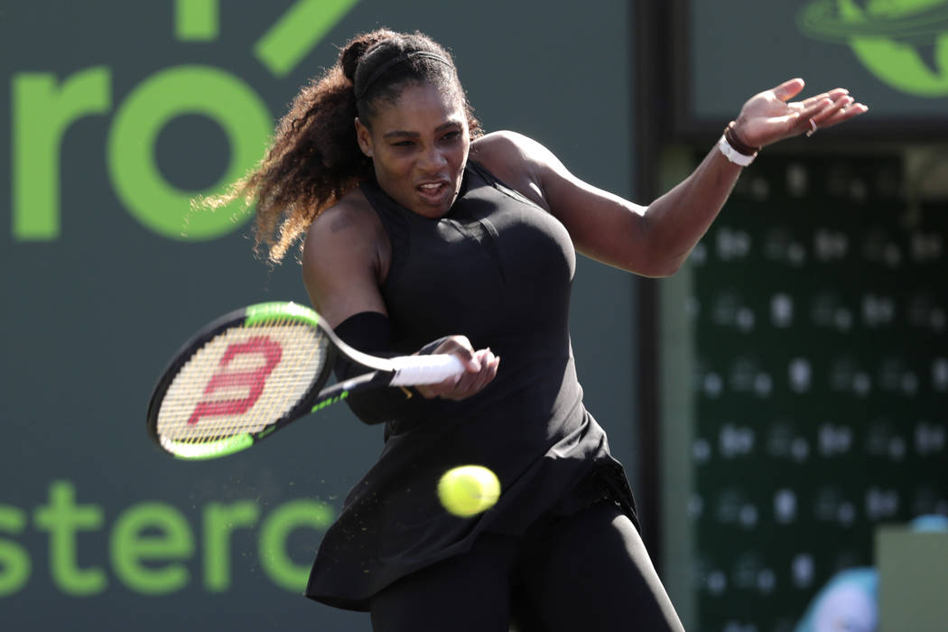In this photo taken on Wednesday, March 21, 2018, Serena Williams returns to Naomi Osaka of Japan, during the Miami Open tennis tournament, in Key Biscayne, Fla. (AP Photo/Lynne Sladky)