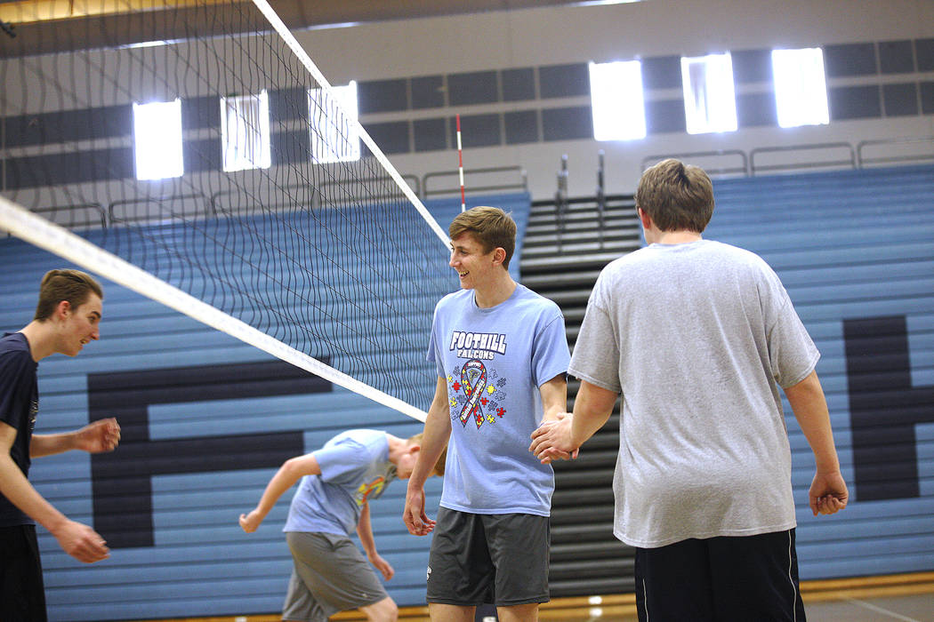 Caleb Stearman, 17, of the Foothill High School mens volleyball team, center, shakes hands with Chandler Higbee, 17, during practice at Foothill High School in Henderson, Monday, May 14, 2018. Ste ...