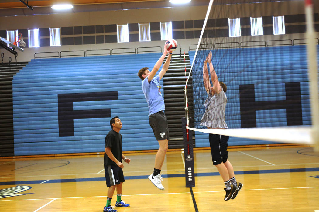 Caleb Stearman, 17, of the Foothill High School mens volleyball team, spikes the ball during practice at Foothill High School in Henderson, Monday, May 14, 2018. Stearman is both a setter on the v ...