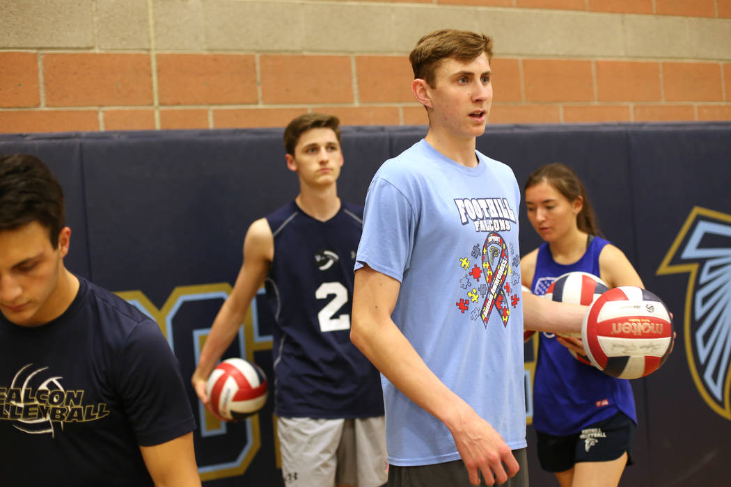 Caleb Stearman, 17, of the Foothill High School mens volleyball team, prepares to serve during practice at Foothill High School in Henderson, Monday, May 14, 2018. Stearman is both a setter on the ...