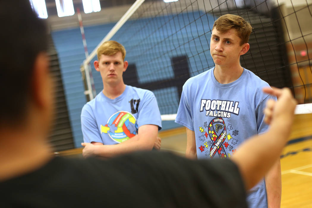 Nathan Cain, left, and Caleb Stearman, 17, of the Foothill High School mens volleyball team, listen to Coach Lewis Miranda during practice at Foothill High School in Henderson, Monday, May 14, 201 ...