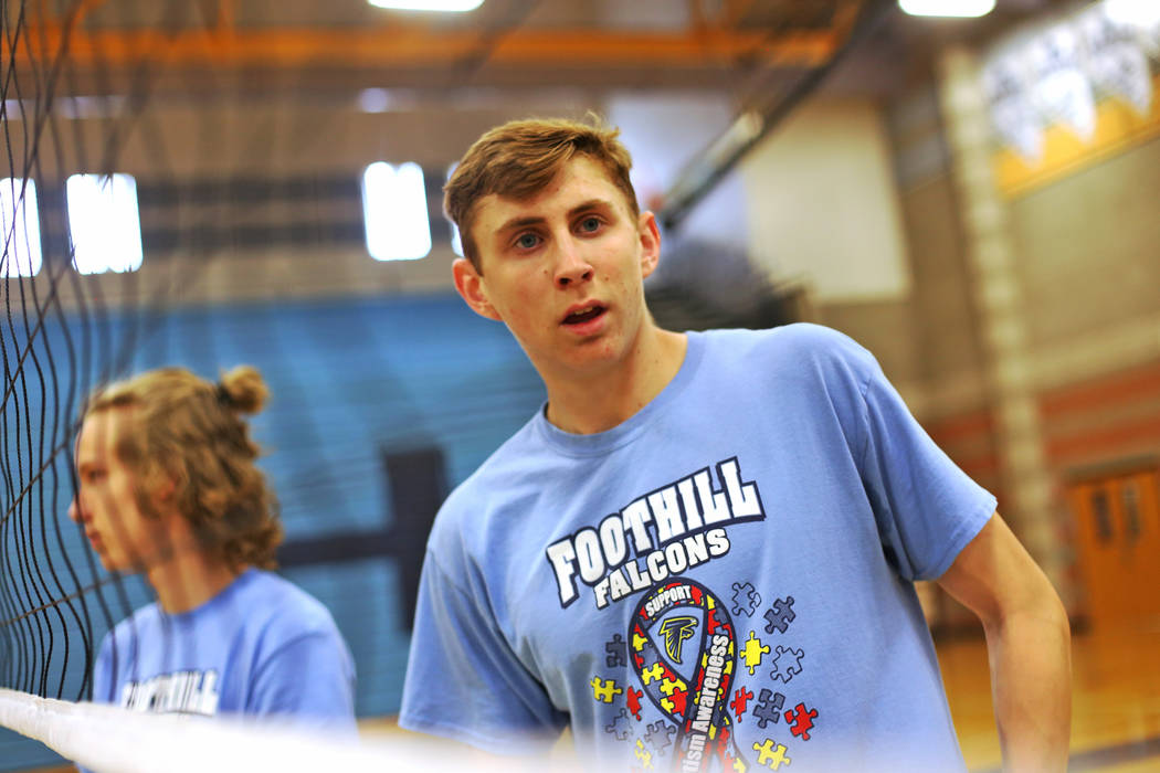 Caleb Stearman, 17, of the Foothill High School mens volleyball team, listens to direction from Coach Lewis Miranda during practice at Foothill High School in Henderson, Monday, May 14, 2018. Stea ...