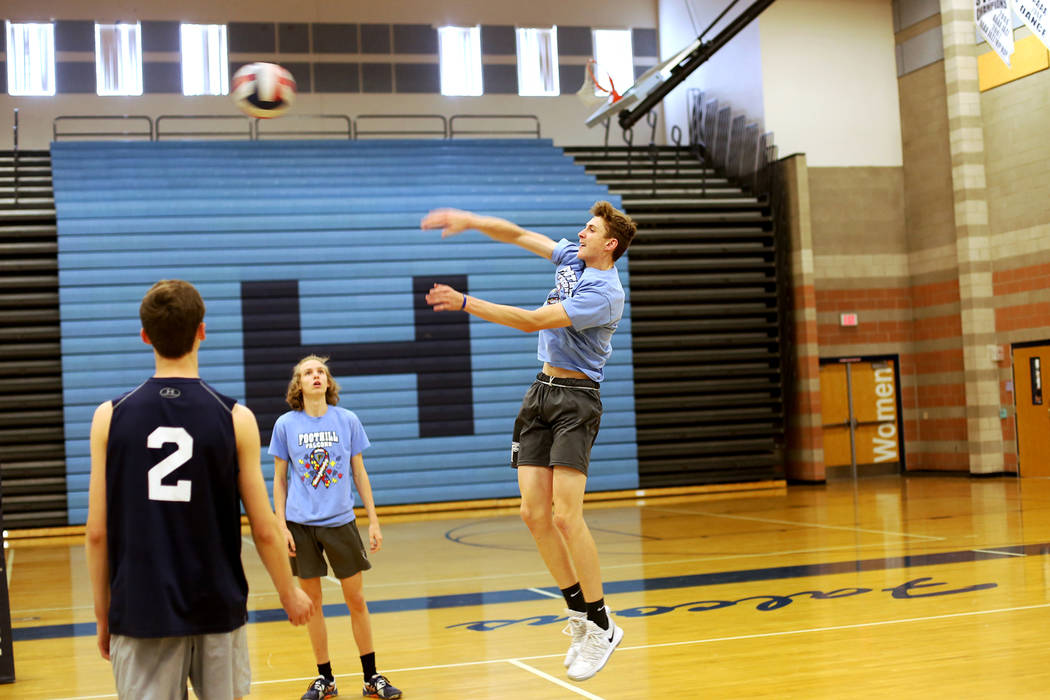 Caleb Stearman, 17, of the Foothill High School mens volleyball team, hits the ball during practice at Foothill High School in Henderson, Monday, May 14, 2018. Stearman is both a setter on the vol ...