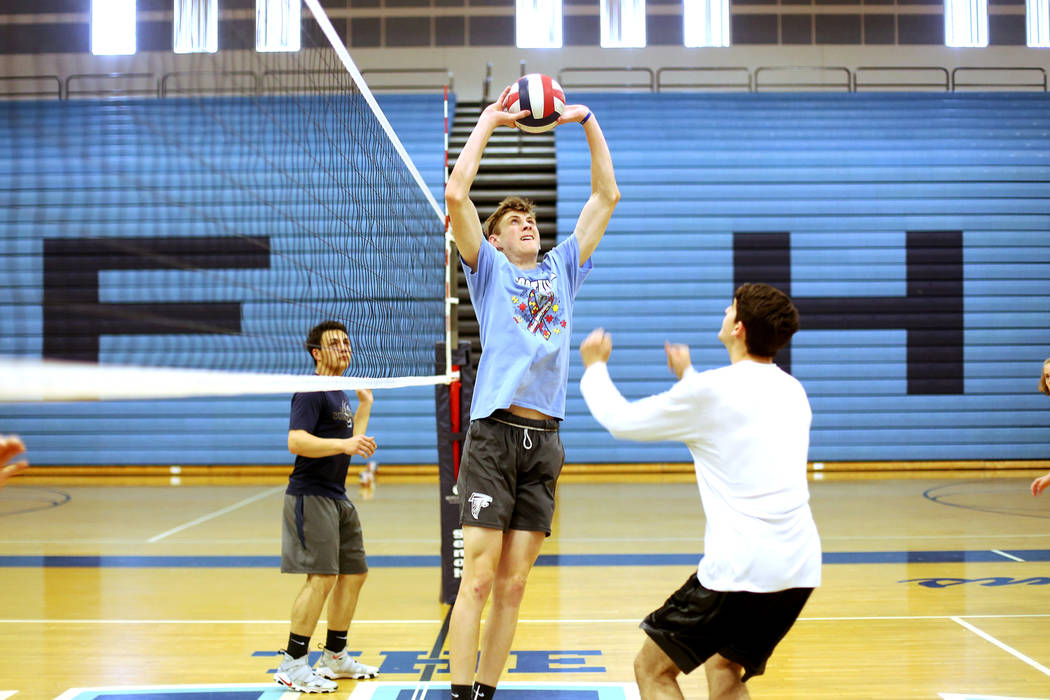 Caleb Stearman, 17, of the Foothill High School mens volleyball team, sets the ball for teammate Truss Erb during practice at Foothill High School in Henderson, Monday, May 14, 2018. Stearman is b ...