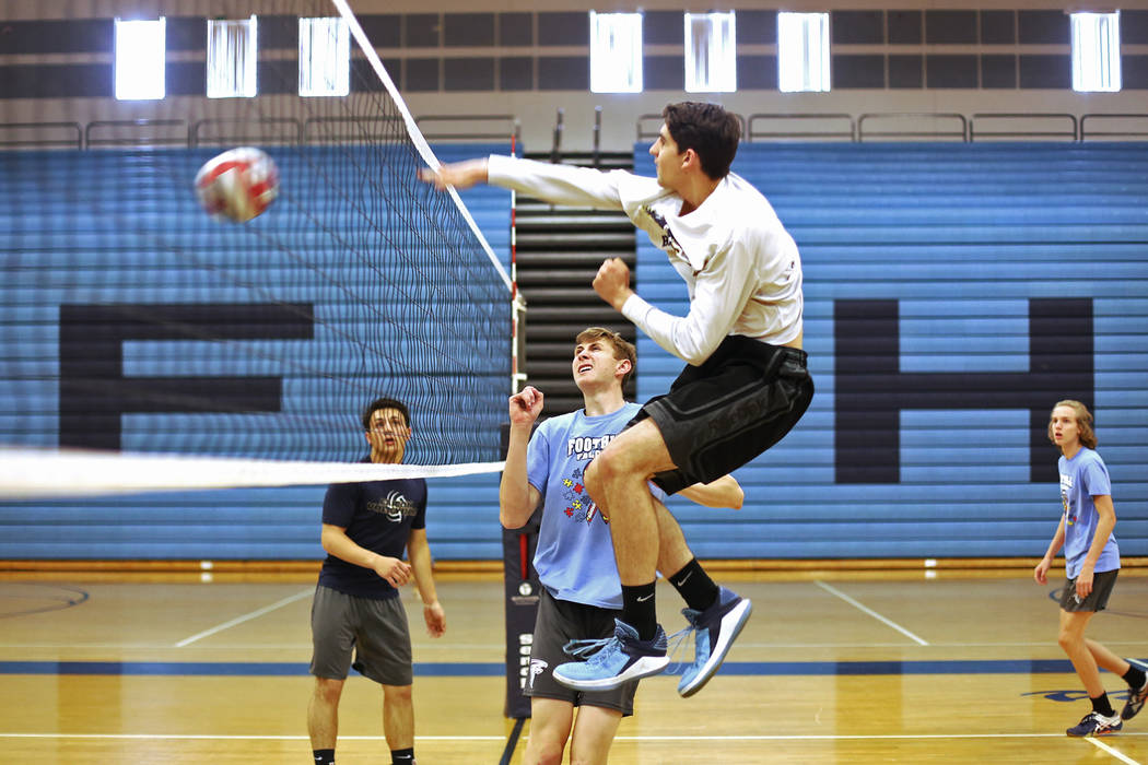 Caleb Stearman, 17, of the Foothill High School mens volleyball team, watches teammate Truss Erb spike the ball during practice at Foothill High School in Henderson, Monday, May 14, 2018. Stearman ...