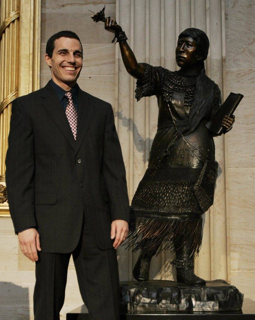 Sculptor Benjamin Victor stands next to the statue of Sarah Winnemucca, a Paiutes, during unveiling ceremony in the Capitol Rotunda in Washington, Wednesday, March 9, 2005. (AP Photo/Susan Walsh)