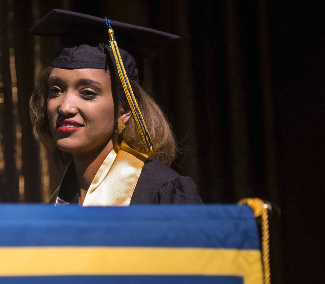Niyat Teweldebrhan, a 28-year-old Eritrean refugee who survived war in her home country, waits on stage to receive her Masters of Science in medical health sciences from the College of O ...