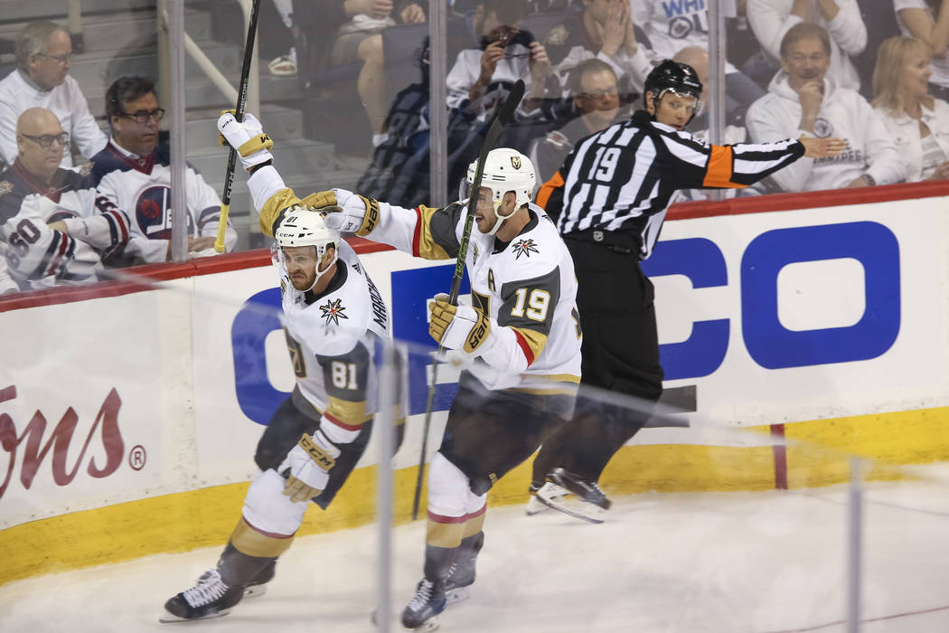 Vegas Golden Knights center Jonathan Marchessault (81) celebrates with Reilly Smith (19) after scoring against the Winnipeg Jets in first period in Game 1 of an NHL hockey third round playoff seri ...