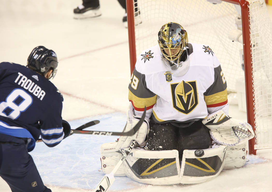 Vegas Golden Knights goaltender Marc-Andre Fleury (29) block a shot from Winnipeg Jets defenseman Jacob Trouba (8) during the first period in Game 1 of an NHL hockey third round playoff series at ...