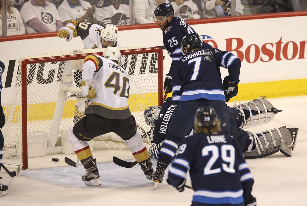 Vegas Golden Knights center Ryan Carpenter (40) scores against the Winnipeg Jets during the first period in Game 1 of an NHL hockey third round playoff series at the Bell MTS Place in Winnipeg, Ca ...