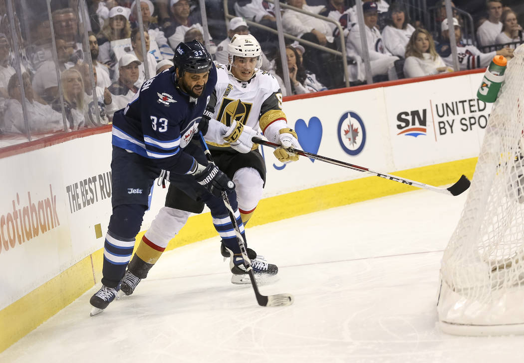 Winnipeg Jets defenseman Dustin Byfuglien (33) keeps the away from Vegas Golden Knights left wing Tomas Nosek (92) during the second period in Game 2 of an NHL hockey third round playoff series at ...