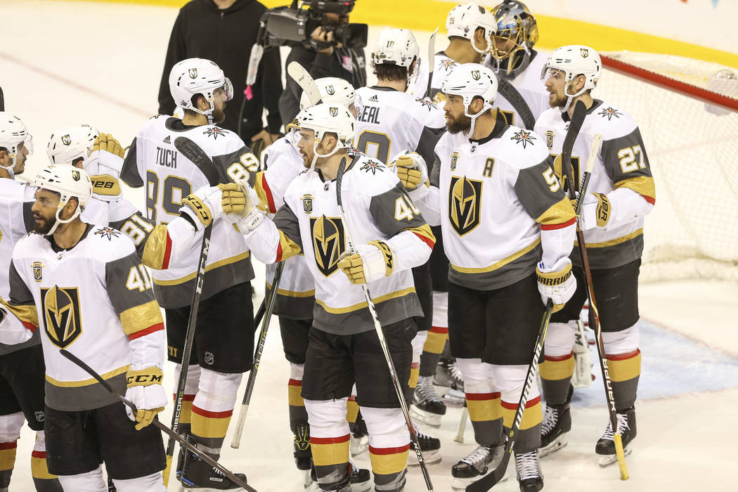 The Vegas Golden Knights celebrate their 3-1 victory over the Winnipeg Jets in Game 2 of an NHL hockey third round playoff series at the Bell MTS Place in Winnipeg, Canada, on Saturday, May 12, 20 ...
