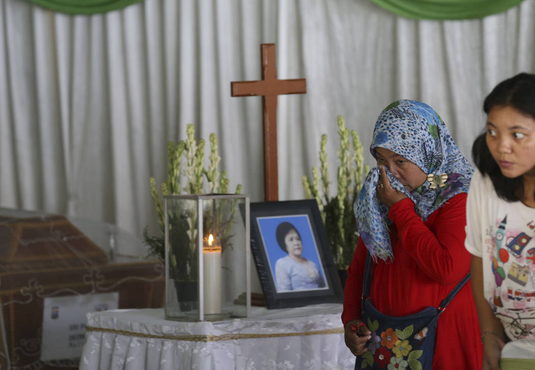 A Muslim woman weeps during the wake for Sri Pudji Astutik, one of the victims of Sunday's church attacks, at a funeral home in Surabaya, East Java, Indonesia, Monday, May 14, 2018. The flurry of ...