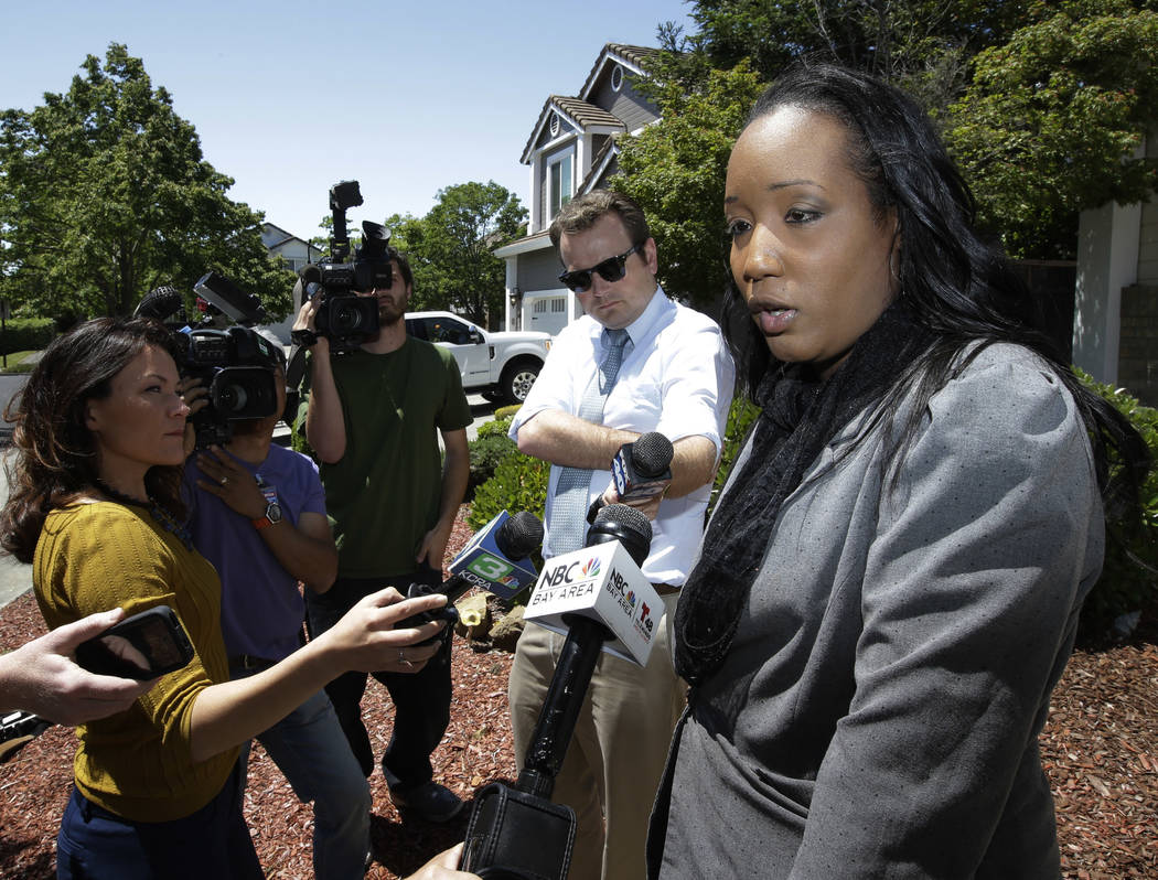 Ina Rogers talks with reporters about the seizure of her 10 children by law enforcement Monday, May 14, 2018, in Fairfield, Calif. Authorities removed the children living at their home on March 31 ...