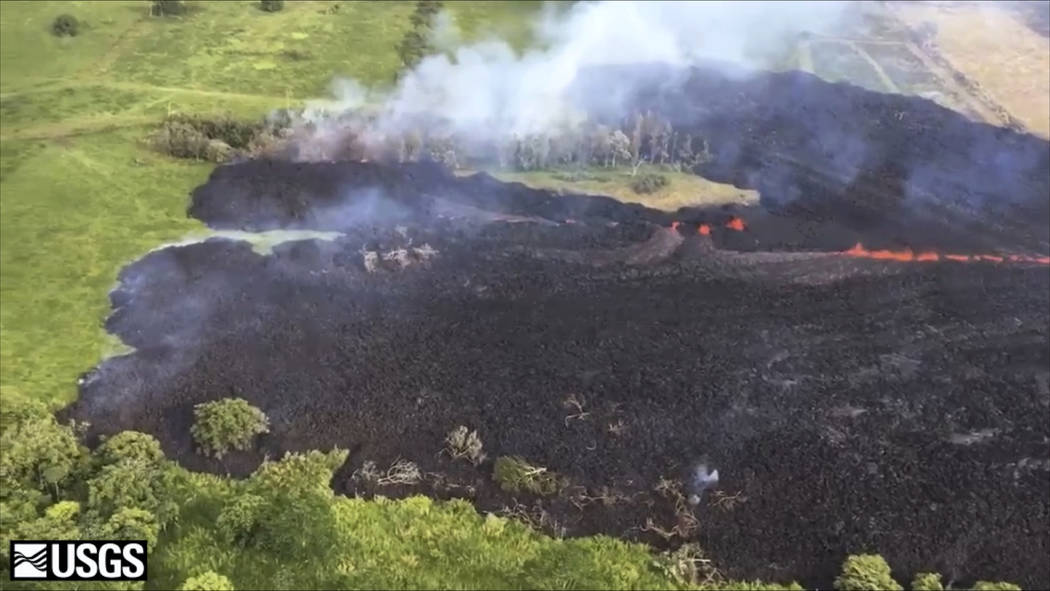 In this May 13, 2018 frame from video released by the U.S. Geological Survey, gases rise from a fissure near Pahoa, Hawaii. The new fissure sent gases and lava exploding into the air, spurring off ...