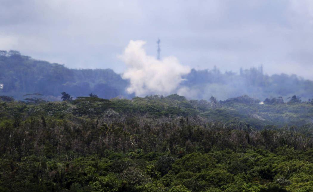 Volcanic gases and ash rise from recent lava fissures near Pahoa, Hawaii on Monday, May 14, 2018. People nixing vacations to Hawaii's Big island has cost the tourism industry millions of dollars a ...