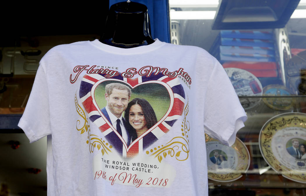 A T-shirt is seen for sale in Windsor, England, Monday, May 14, 2018. Preparations are being made in the town ahead of the wedding of Britain's Prince Harry and Meghan Markle that will take place ...