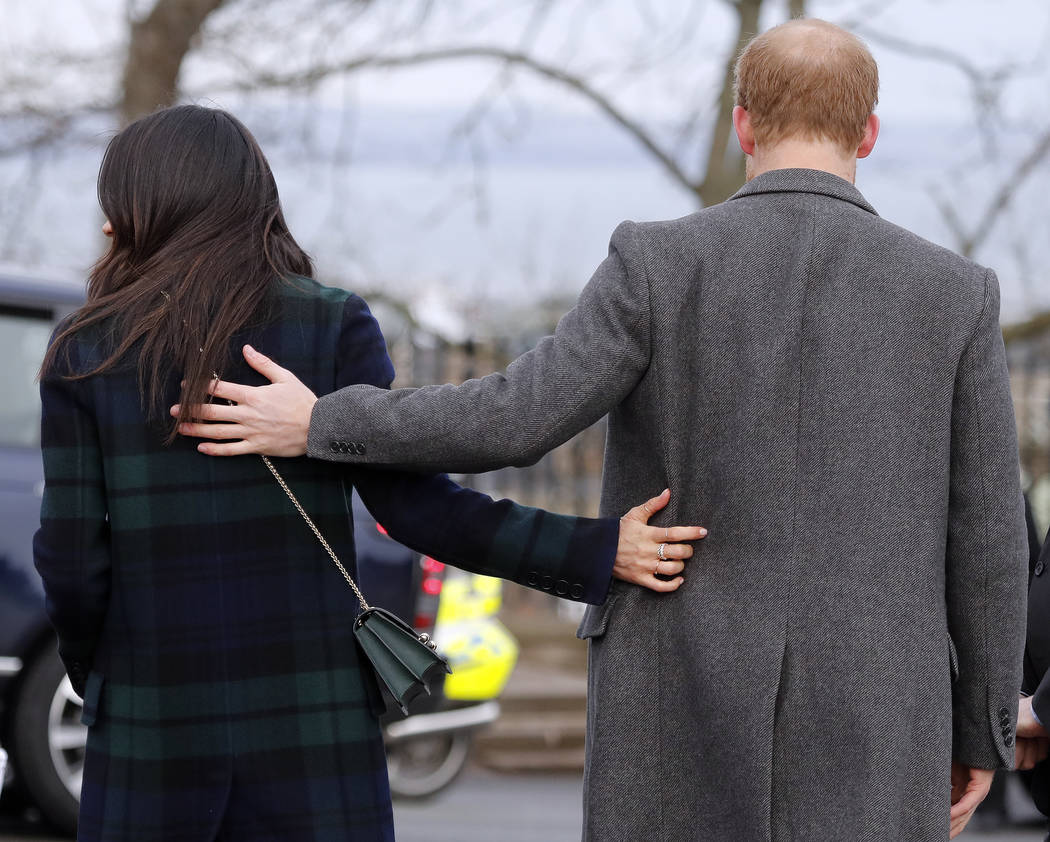 FILE - In this file photo dated Tuesday, Feb. 13, 2018, Britain's Prince Harry and his fiancee Meghan Markle arrive at Edinburgh Castle in Edinburgh, Scotland. Kensington Palace said Monday May 14 ...