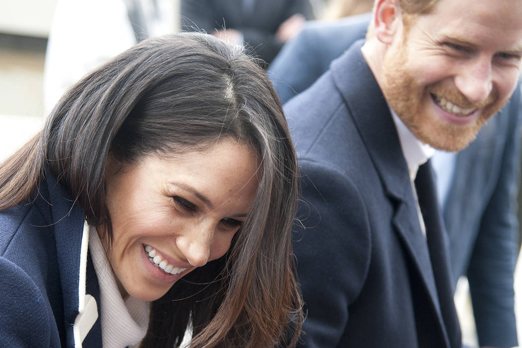 In this file photo dated Thursday March 8, 2018, Britain's Prince Harry and his fiancee Meghan Markle arrive for an event for young women, as part of International Women's Day in Birmingham, centr ...