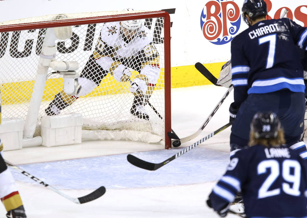 Vegas Golden Knights left wing Tomas Tatar (90) scores from behind the net against the Winnipeg Jets in Game 2 of an NHL hockey third round playoff series at the Bell MTS Place in Winnipeg, Canada ...