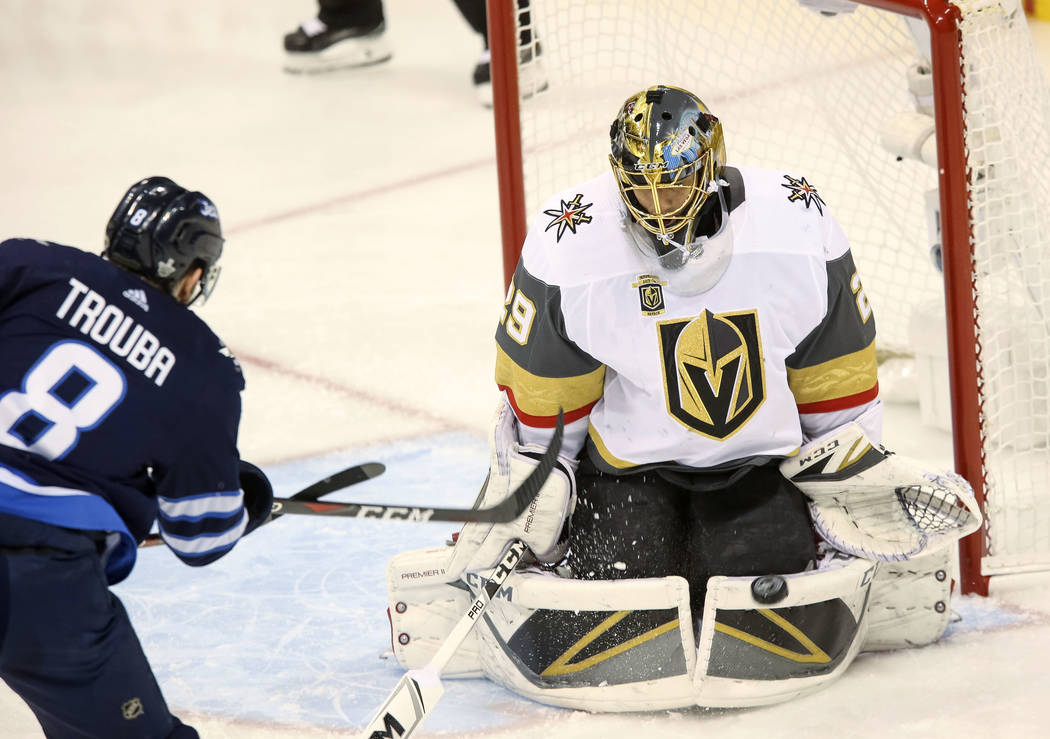 Vegas Golden Knights goaltender Marc-Andre Fleury (29) block a shot from Winnipeg Jets defenseman Jacob Trouba (8) during the first period in Game 2 of an NHL hockey third round playoff series at ...