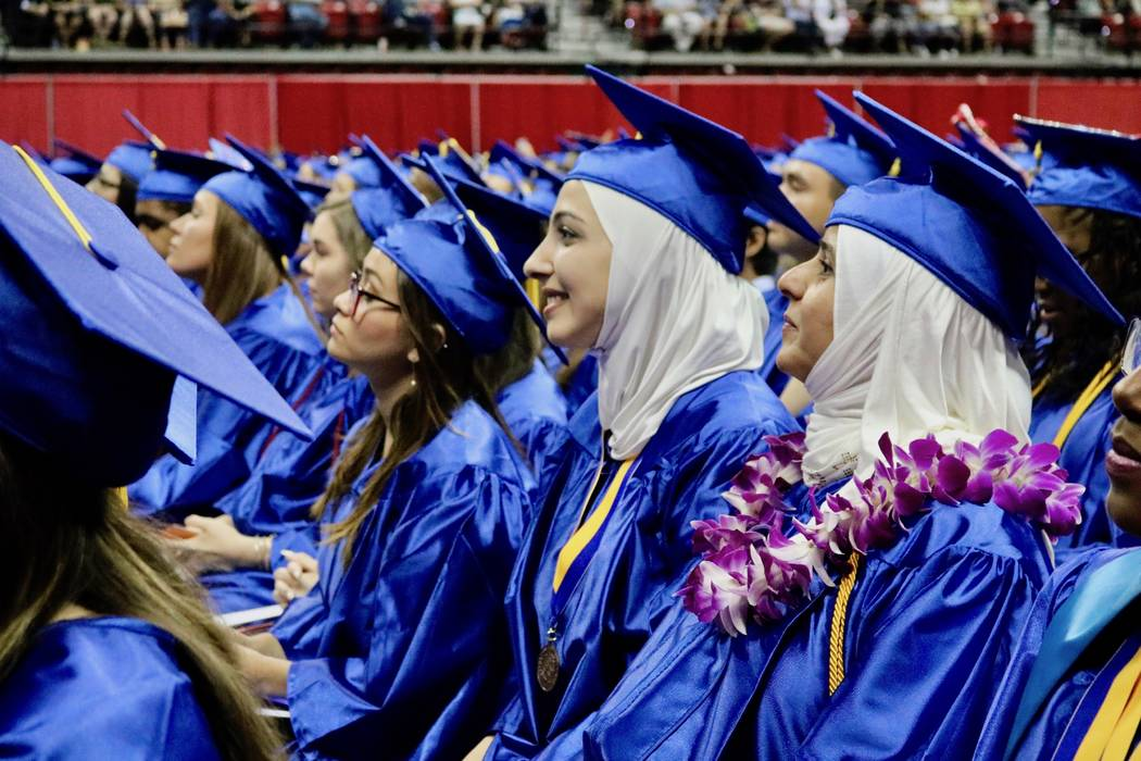 Read Alsayyad, center, and Nedal Kalbi, right, watch The College of Southern Nevada's 46th commencement ceremony at Thomas & Mack Center in Las Vegas, Monday, May 14, 2018. The Class of 2018 w ...