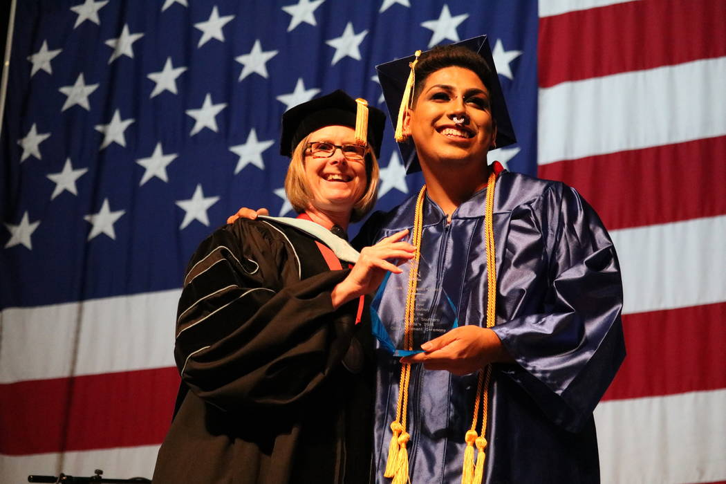 The College of Southern Nevada's student commencement speaker Bryan Rodriguez-Clavel, right, and acting president Dr. Margo L. Martin at the College of Southern Nevada's 46th commencement ceremon ...