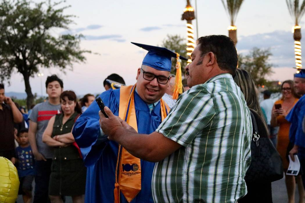 Families celebrate outside after the College of Southern Nevada's 46th commencement ceremony at Thomas & Mack Center in Las Vegas, Monday, May 14, 2018. The Class of 2018 was the school's larg ...