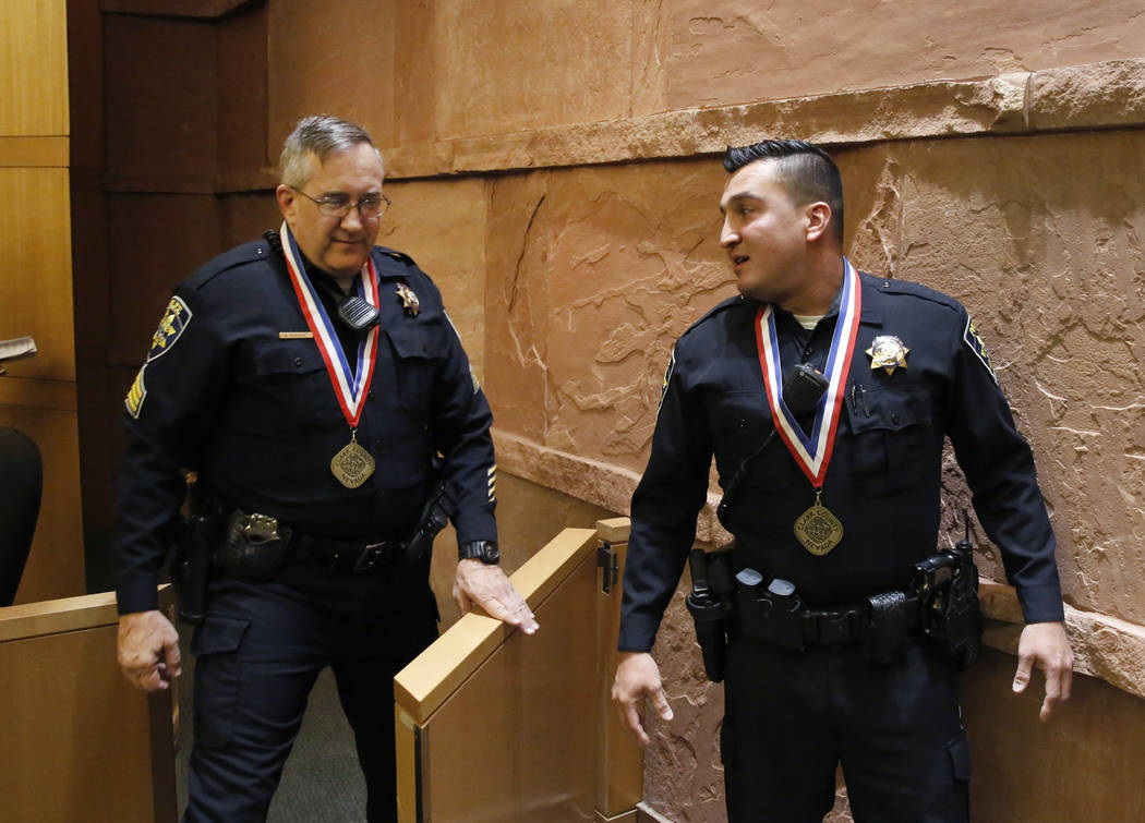 Clark County Park Police Sgt. Wade Barnhart, left, and officer Anthony Guerrero, who responded to a shooting at Sunset Park during a party for Venetian employees, exit the Clark County Commission ...