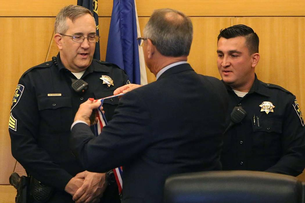 Clark County Park Police Sgt. Wade Barnhart, left, and officer Anthony Guerrero, who responded to a shooting at Sunset Park during a party for Venetian employees, were recognized with medals for e ...