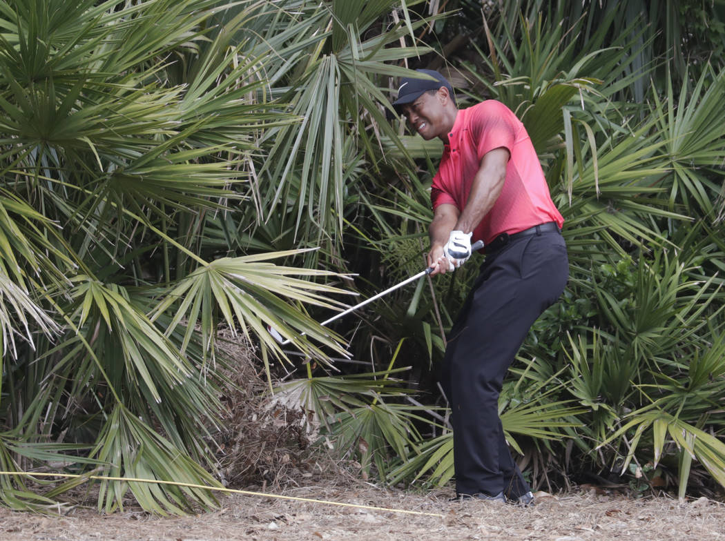 Tiger Woods hits from the rough off the second hole fairway, during the final round of the Players Championship golf tournament, Sunday, May 13, 2018, in Ponte Vedra Beach, Fla. (AP Photo/Lynne Sl ...